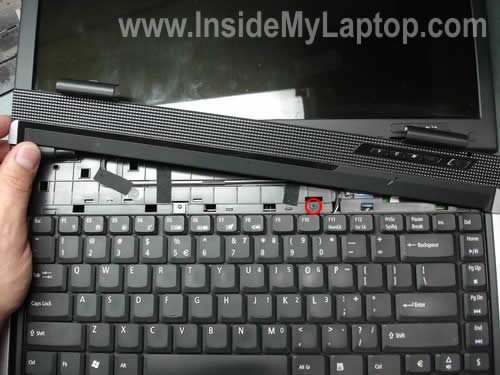 Remove screw from keyboard
