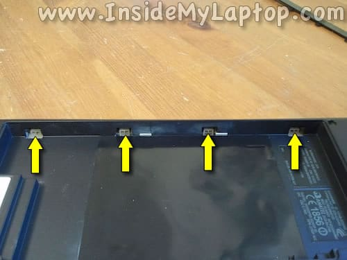 Palm rest tabs