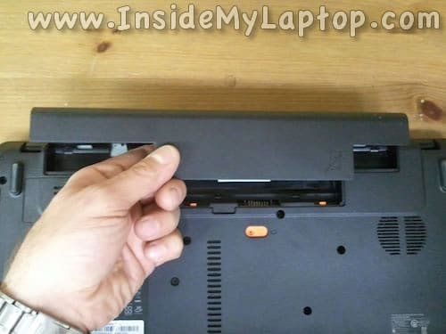 Unlock and remove laptop battery