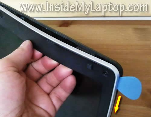 Use guitar pick to separate bezel