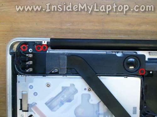 Remove screws securing subwoofer
