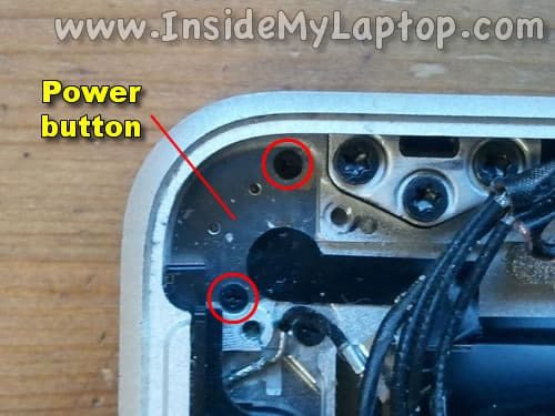 Remove two screws from power button