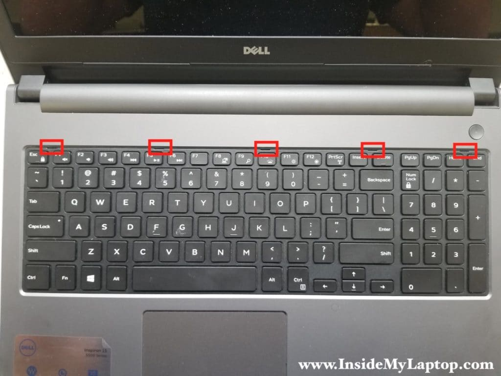 Five latches securing keyboard