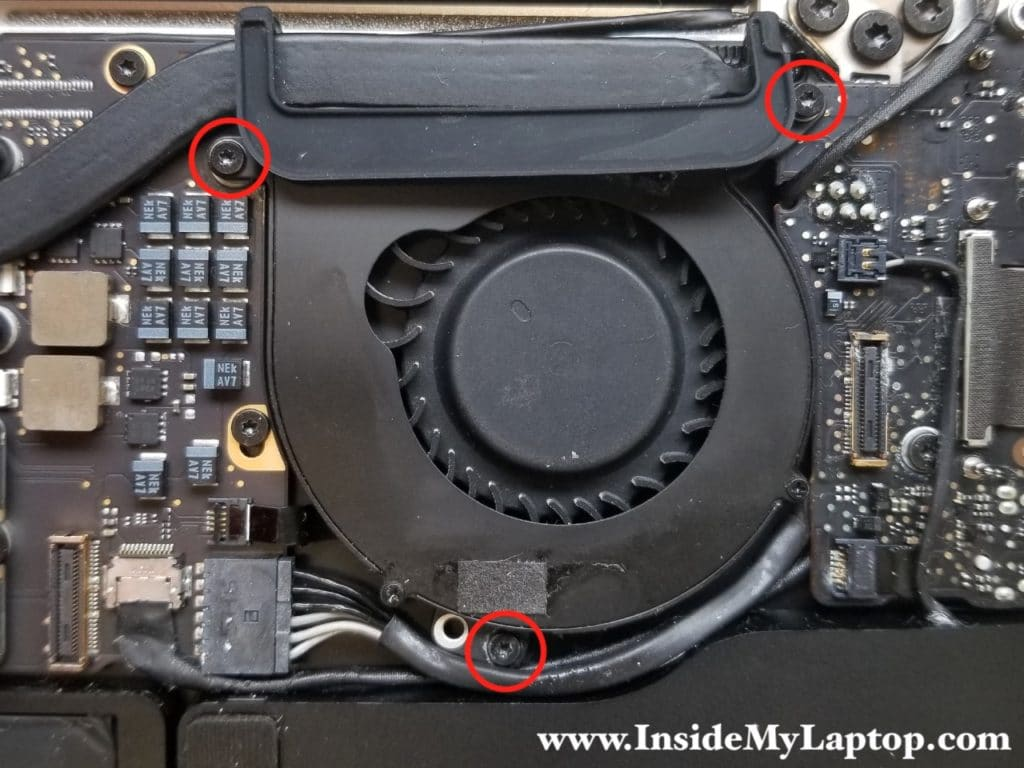 Three screws securing the cooling fan