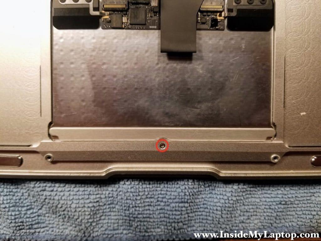 Adjust trackpad click screw