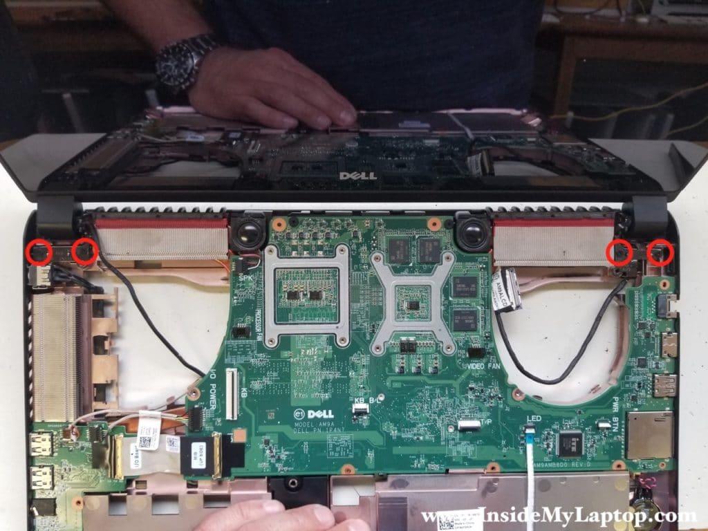 Remove screws securing display hinges
