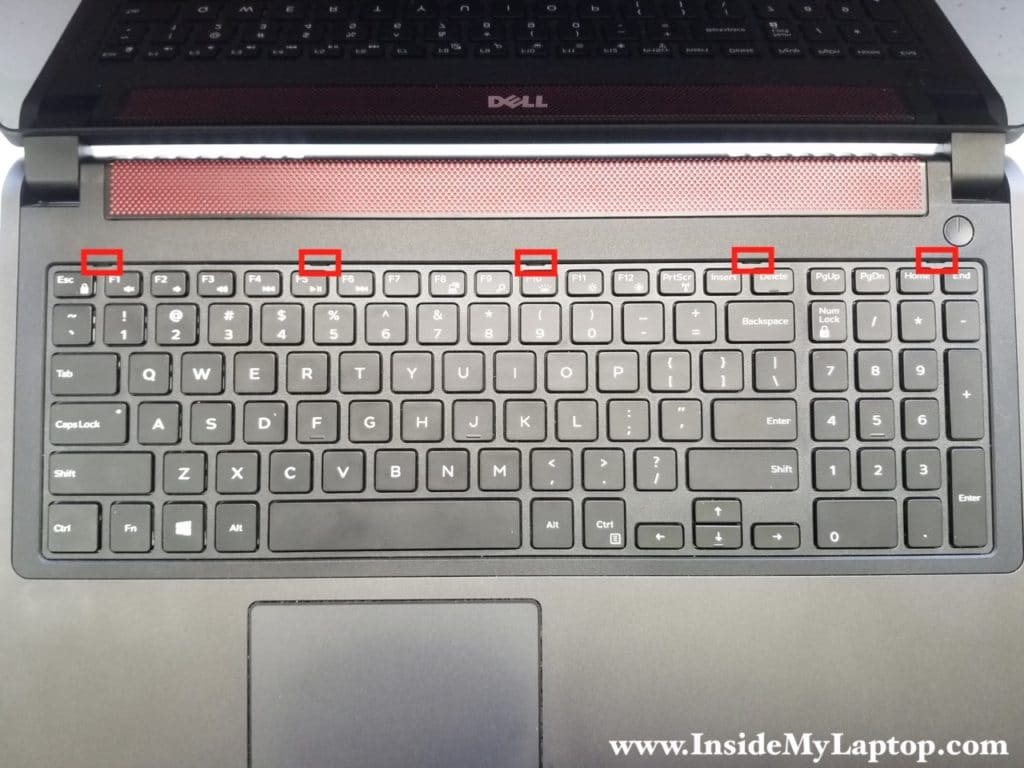Five latches securing keyboard to top case
