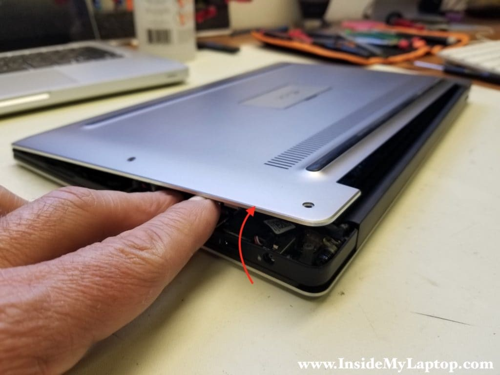 Separate bottom cover from laptop