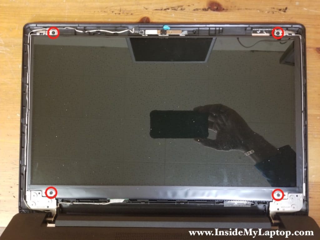 Remove screws securing LCD screen