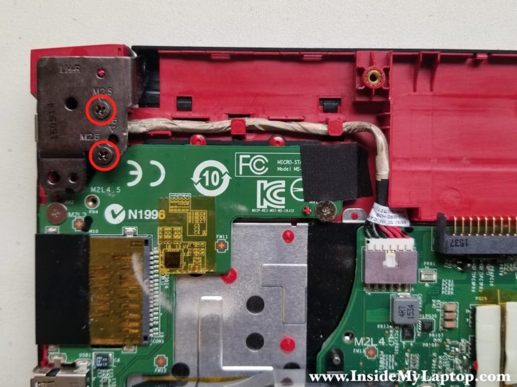 Remove two screws from display hinge