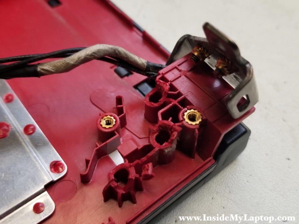Left hinge detached from top case