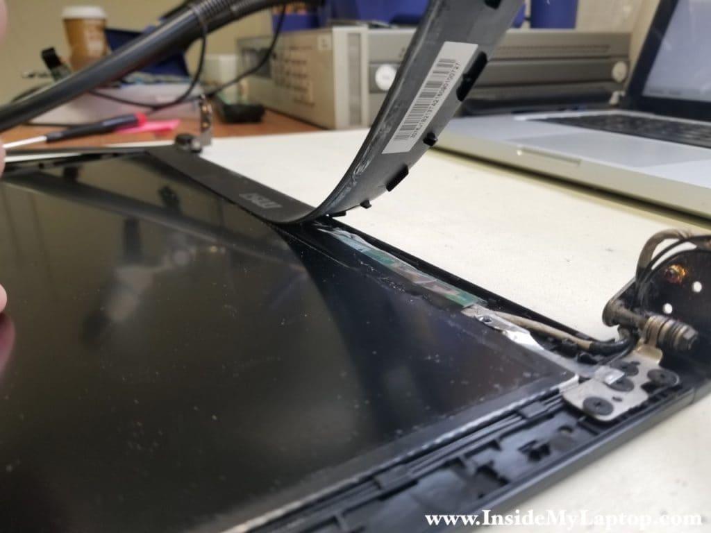 Bezel glued to LCD screen on bottom
