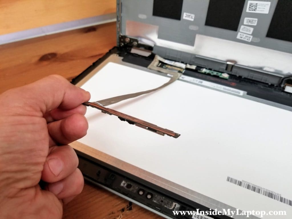 Peel off webcam cable from LCD screen
