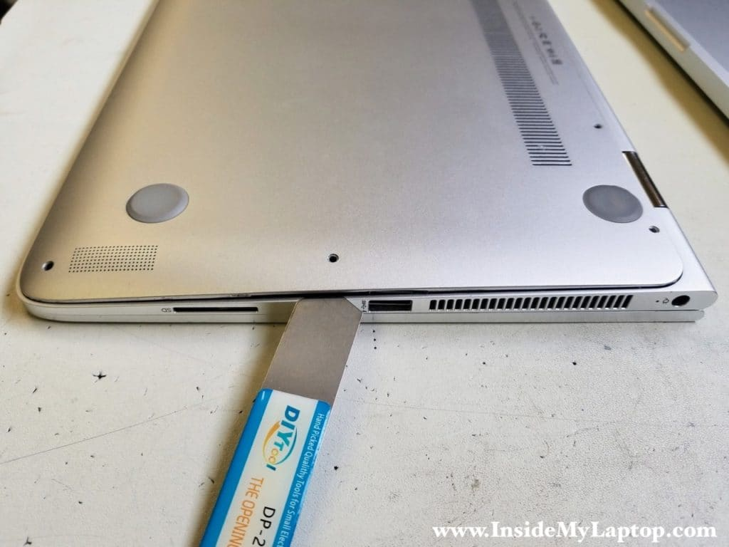 Separate bottom cover from top case assembly