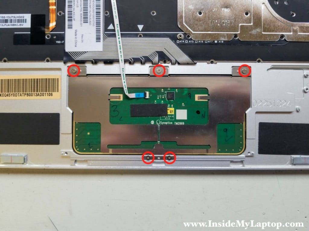 Remove five screws securing touchpad