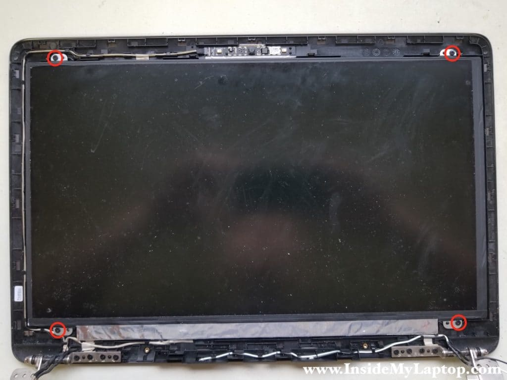 Remove four screws securing LCD screen