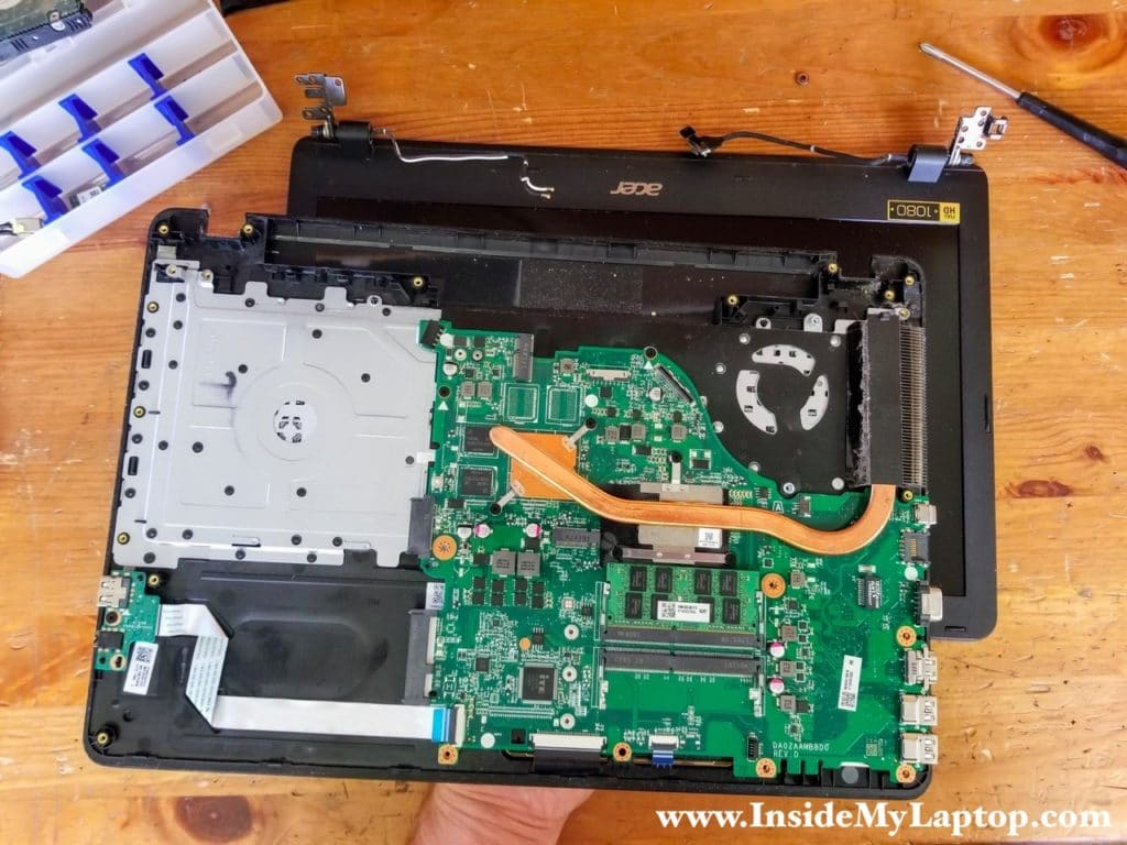 Separate the top case assembly from the display.