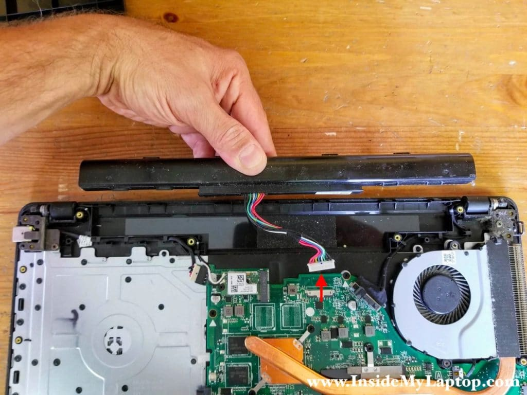 Lift up the battery and disconnect the cable from the motherboard.