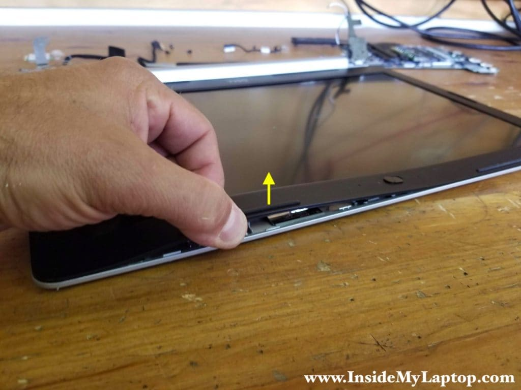Start separating LCD bezel from display cover