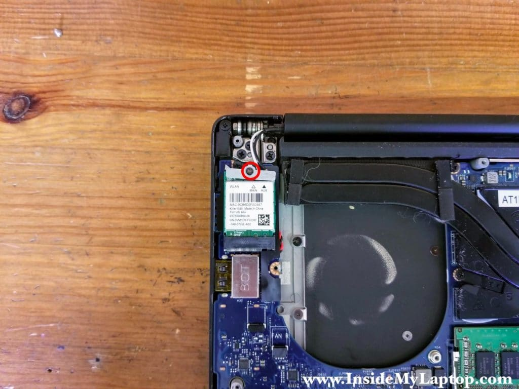 Remove one screw from the wireless card antenna cable cover.