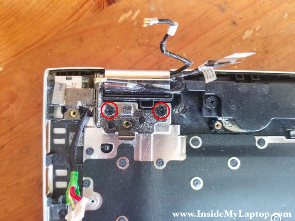 Remove two screws from right display hinge