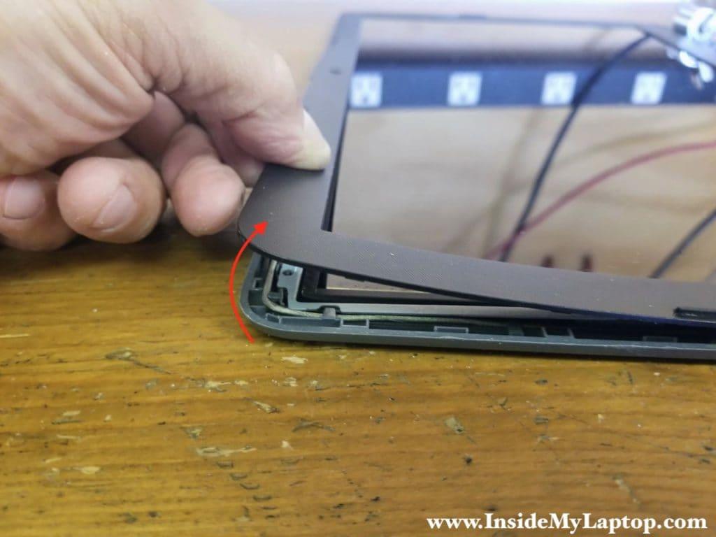 Start separating LCD bezel from back cover