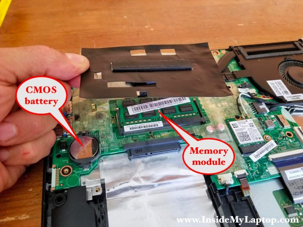 Accessing laptop memory module and CMOS battery.