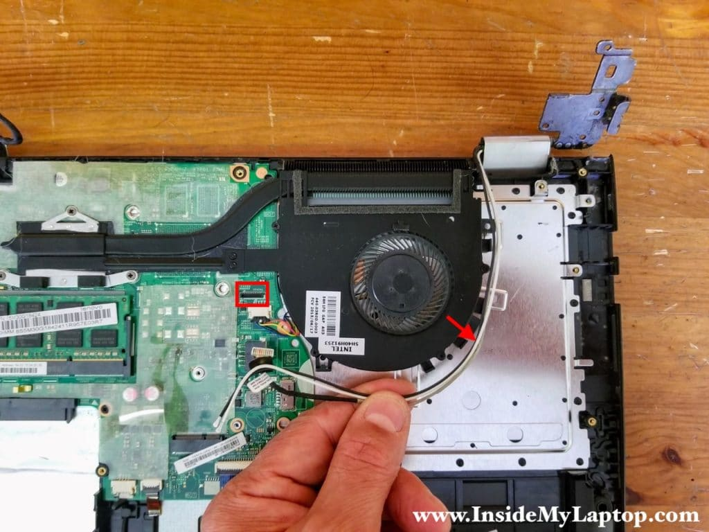 Unplug the webcam cable from the motherboard and unroute all cables from the fan.