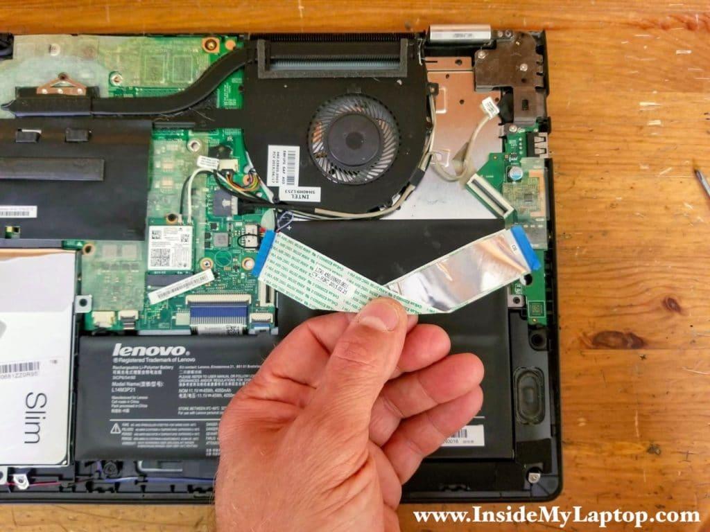 Remove the I/O board cable.