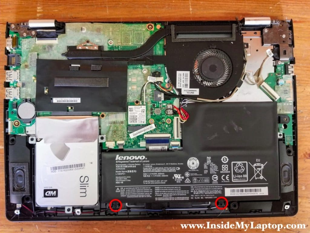 Remove two screw securing the main laptop battery.