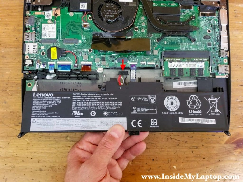 Lift up the battery and unplug the cable from the motherboard.