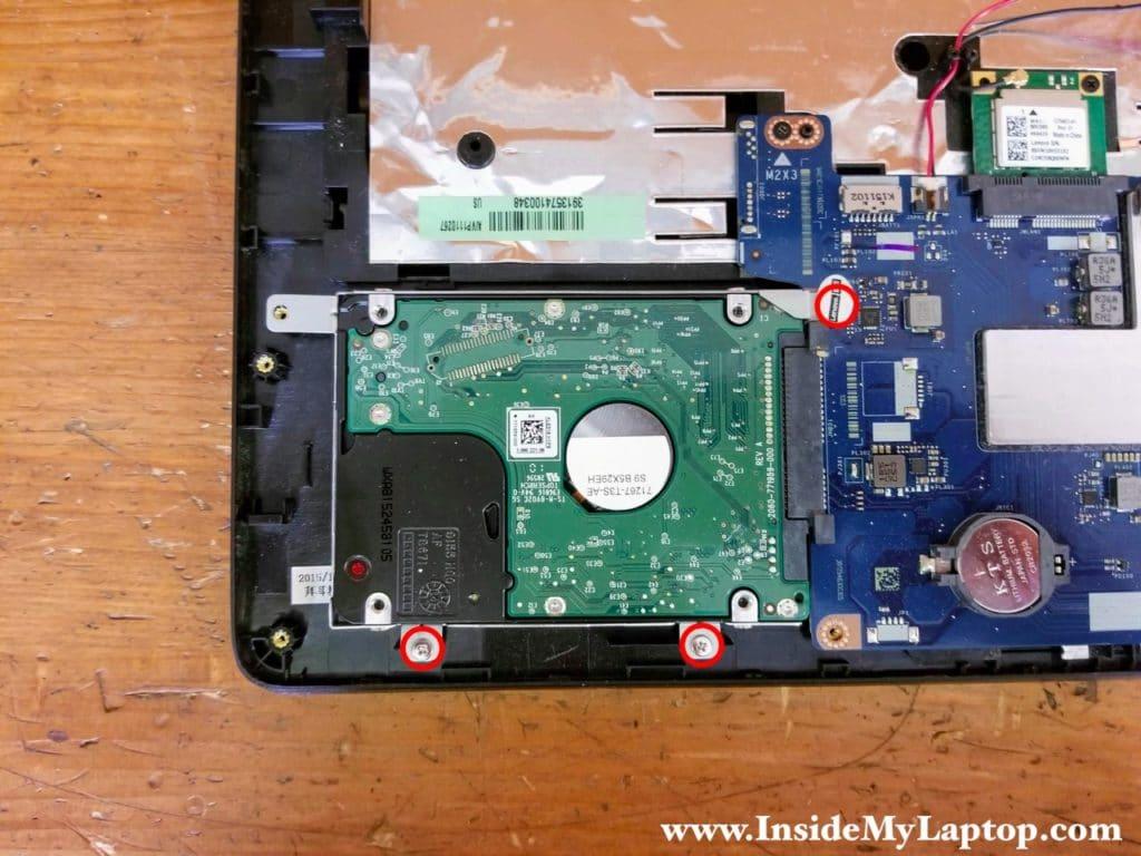 Remove three screws securing the hard drive bracket.
