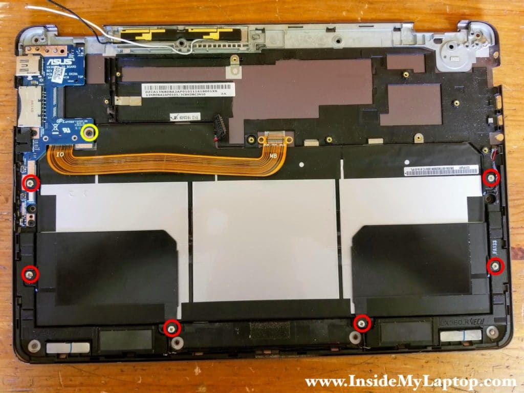 Remove six screws from the battery and one screw from the USB SD card reader board.