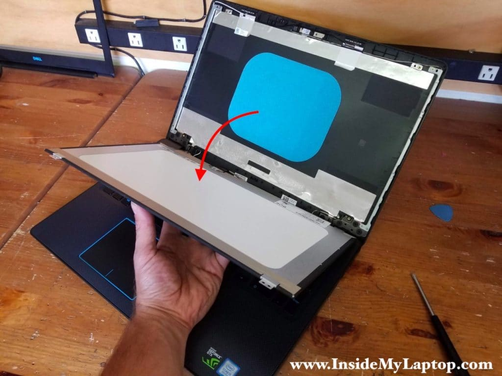 Carefully separate the LCD screen from the back cover and place it on the palmrest.