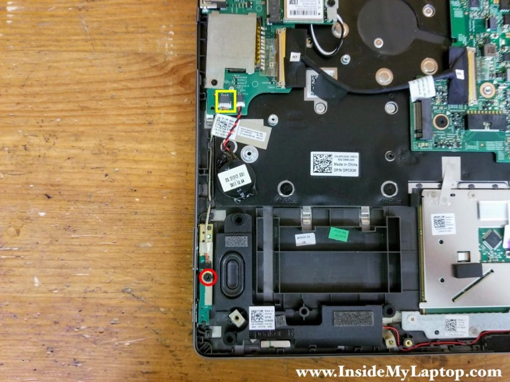 Remove one screw securing the power button and volume control board. Disconnect the cable from the motherboard.