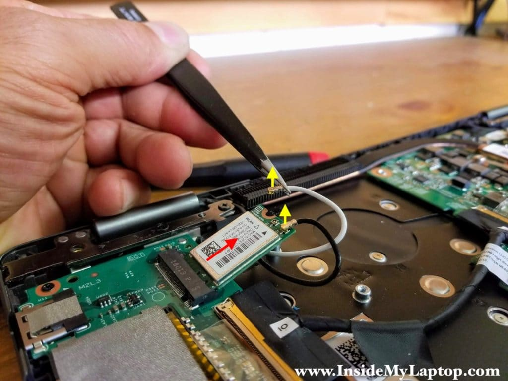 Disconnect both antenna cables from the wireless card and remove the card.