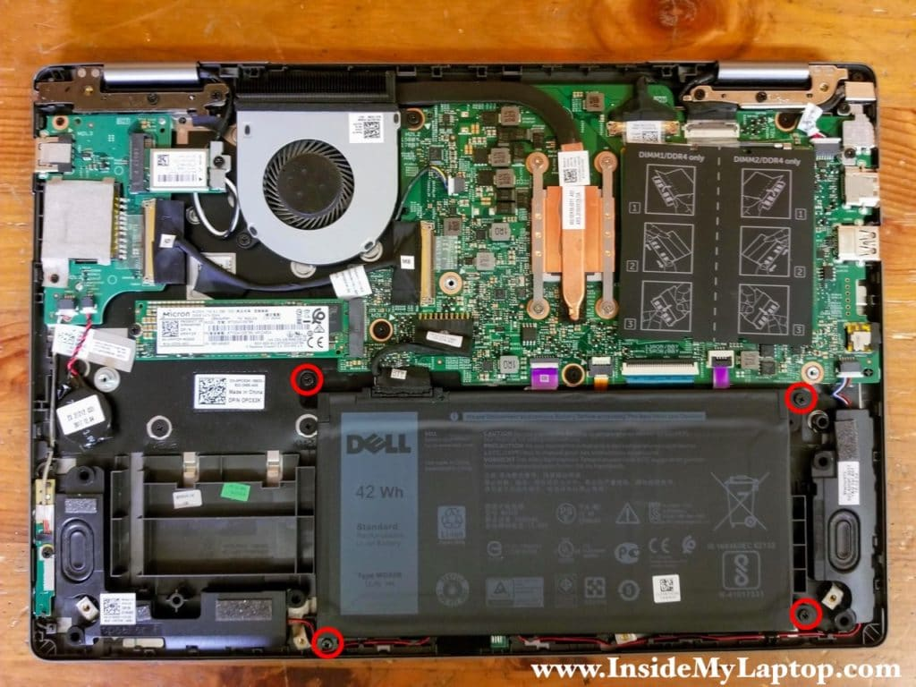 Remove four screws attaching the main battery to the palmrest assembly.