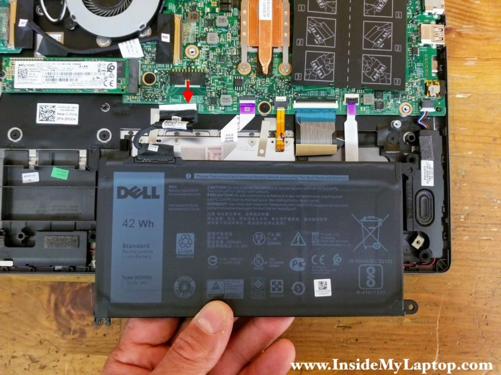 Lift up the battery and disconnect it from the motherboard. Remove the battery.