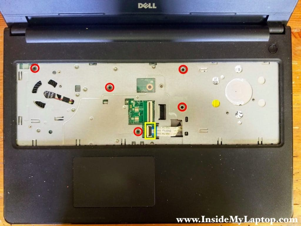 Remove five screws securing the top case and disconnect the optical drive cable from the motherboard.