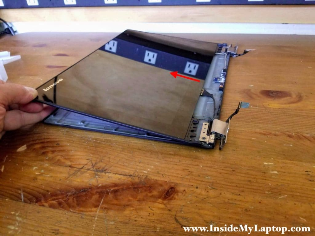 Continue separating the touchscreen assembly from the back cover.