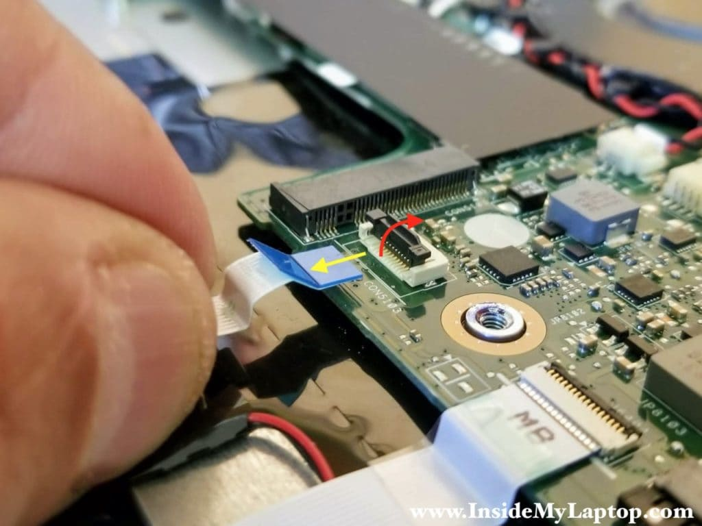 How to unlock the hard drive cable connector and release the cable.