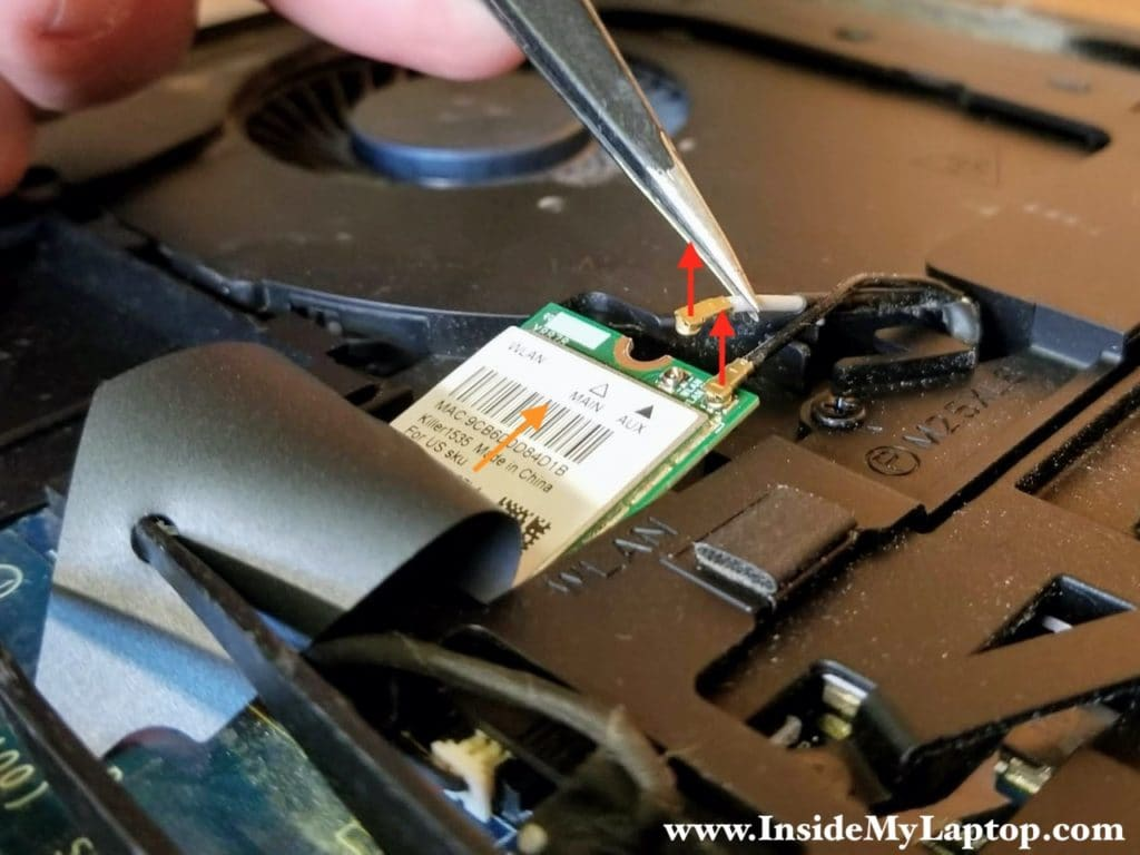 Unplug wireless card antenna cables and remove the card.