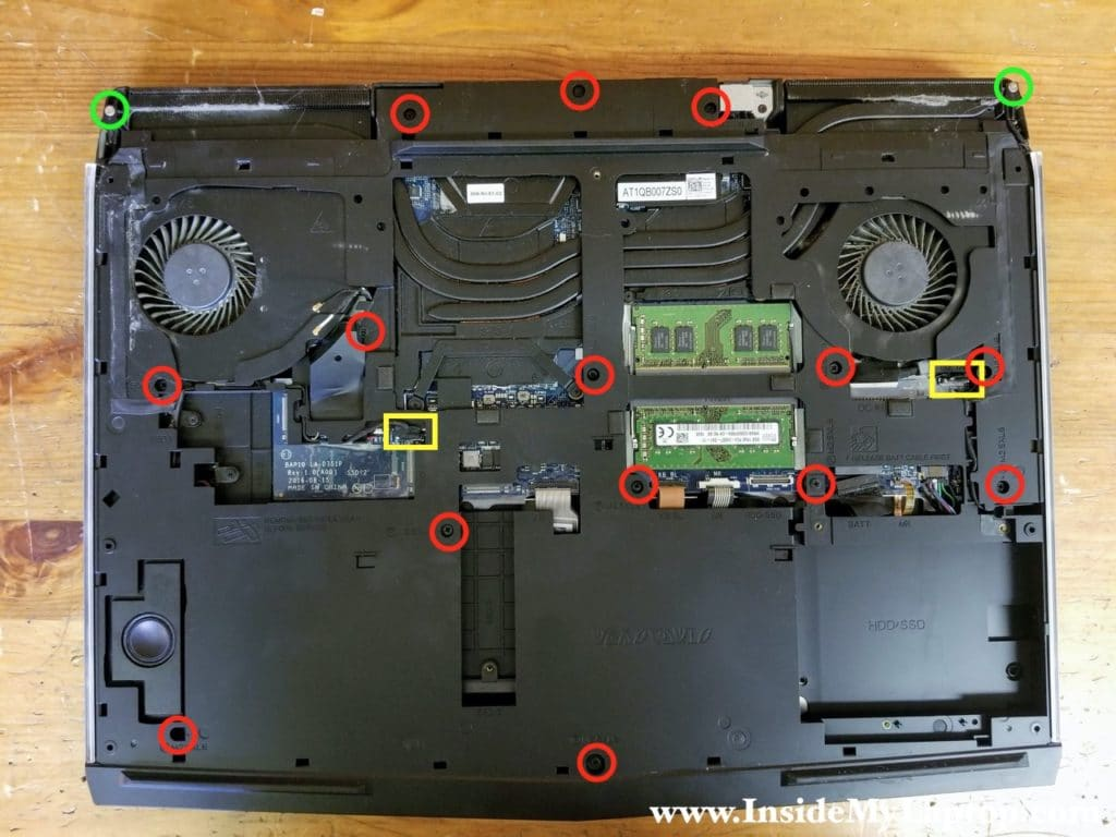 Remove all screws from the computer base and disconnect tron-light cables.