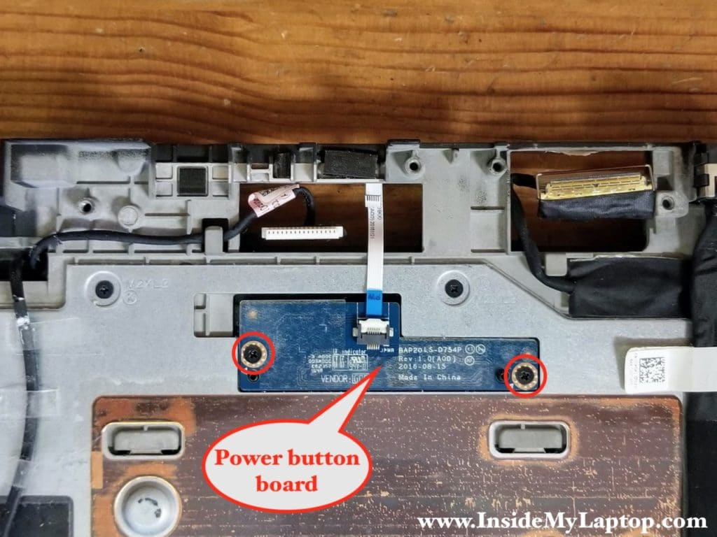 The power button board secured to the palmrest with two screws.