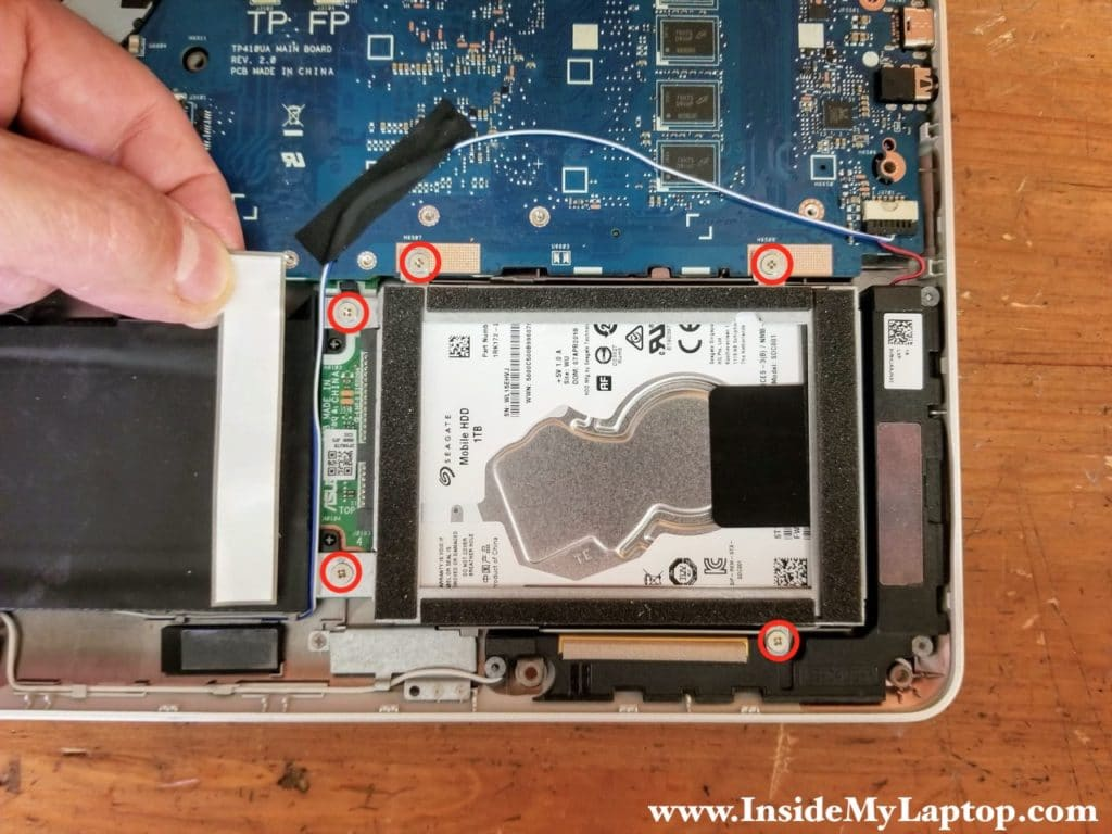 Remove five screws securing the hard drive caddy.
