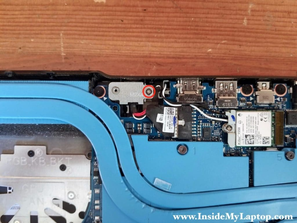 Remove one screw from the DC power jack cover and remove the cover.