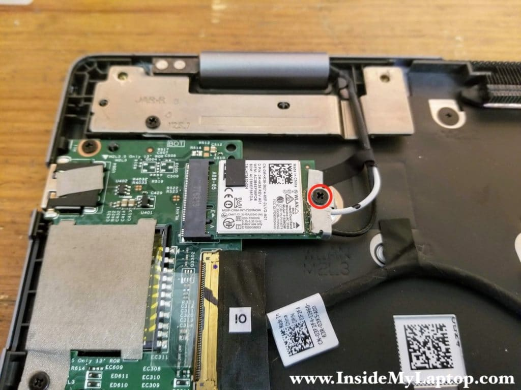Remove one screw from the Wi-Fi card bracket. Remove the bracket.
