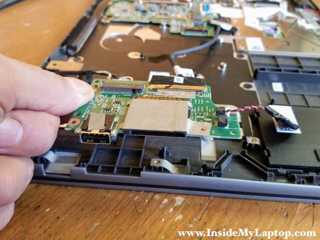 Remove the USB/SD card reader board. The RTC battery is still attached to the board.