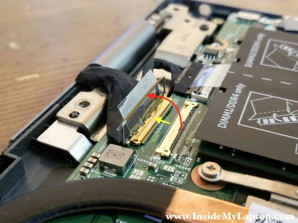 Unlock the display cable connector and pull the cable out.