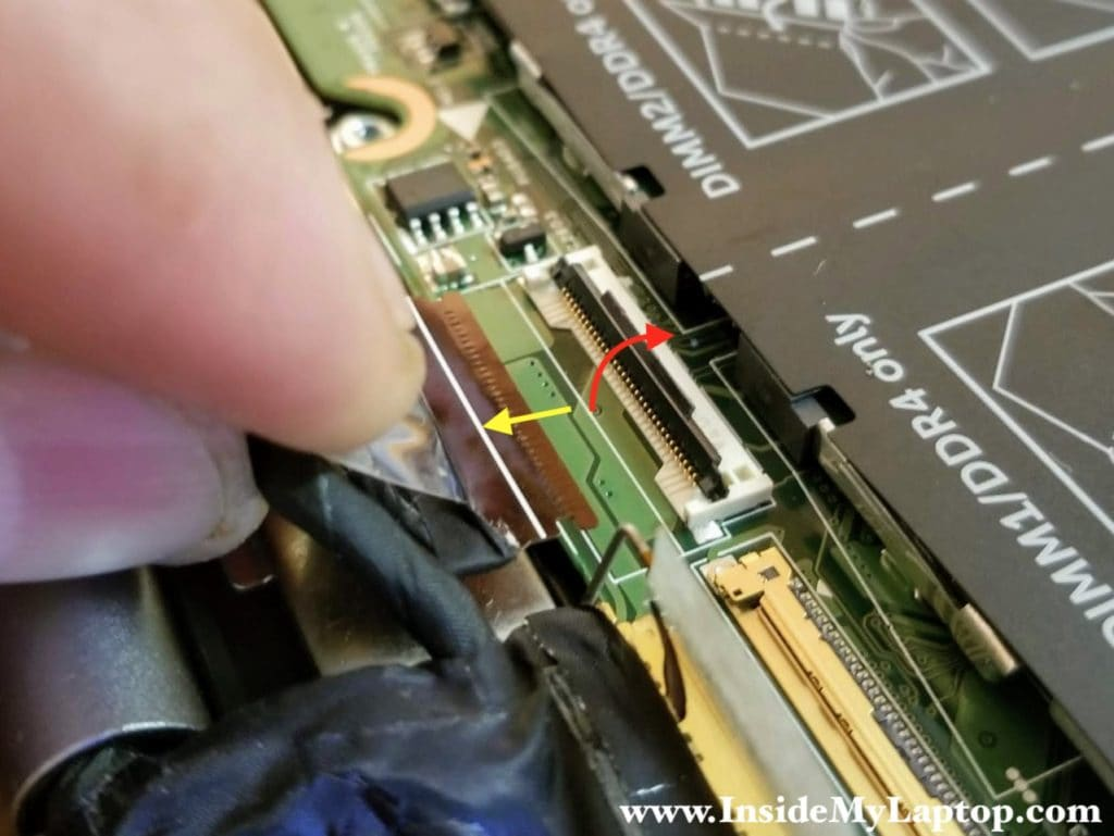 Disconnect the second display cable.